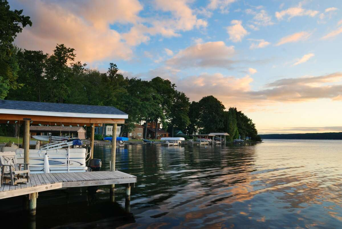 a picture of a lake front home for sale