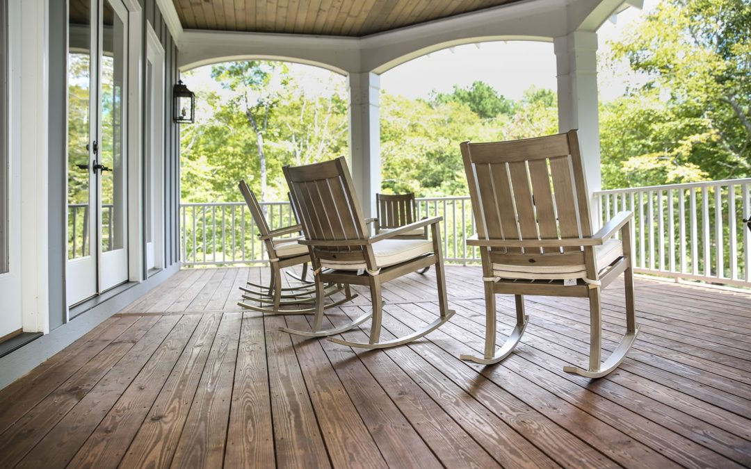 a view from a wooden porch with rocking chairs in Pendleton South Carolina.